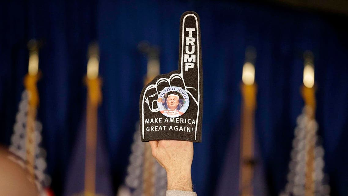 A supporter holds a foam finger sign promoting Republican presidential candidate businessman Donald Trump before he speaks at a primary night rally. (AP)