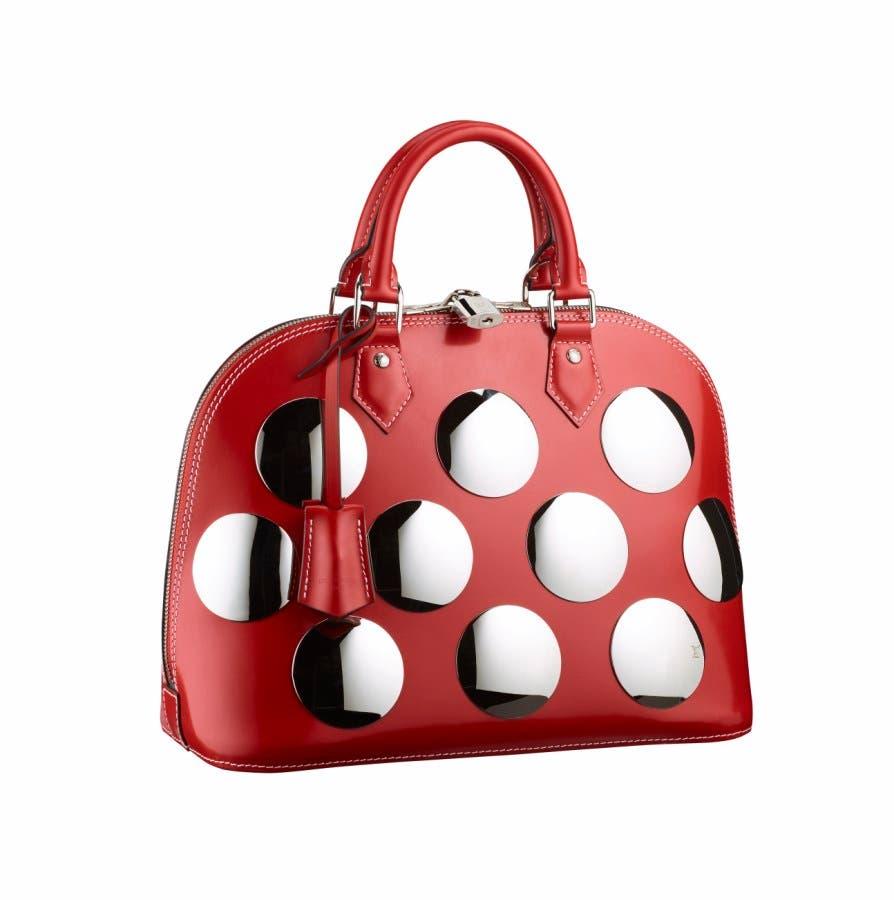 a2add463d13e7 ... حقائب باللون الأحمر لهذا الموسم  Tory Burch. Loewe. Louis Vuitton