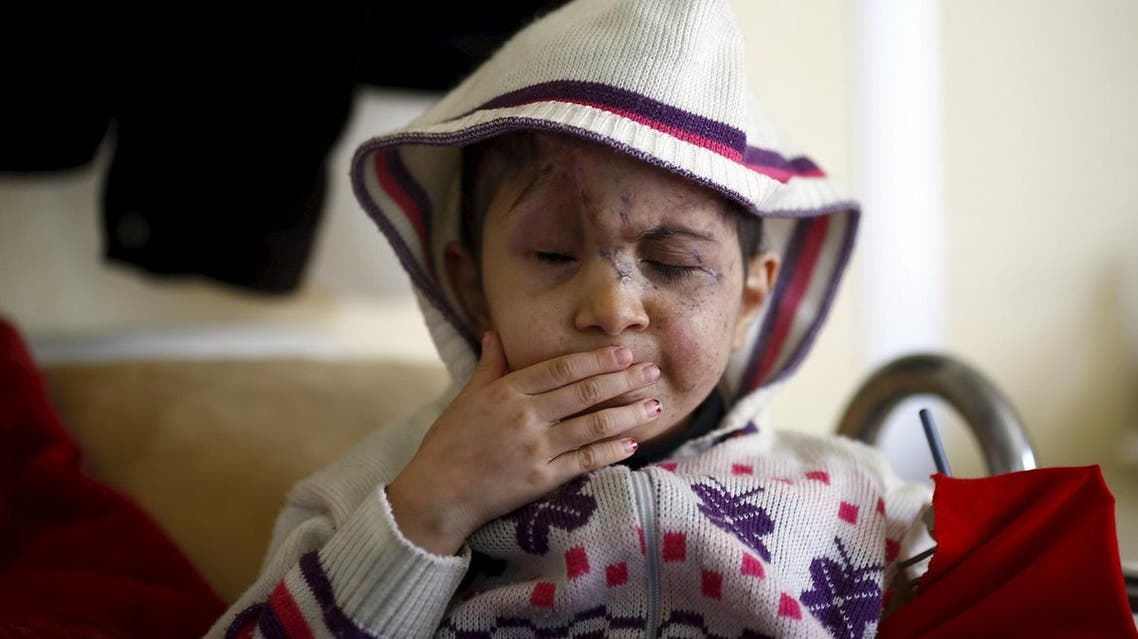 Five-year old Sheima, who lost both eyes when hit by a stray bullet in Syria, sits on her hospital bed in a small clinic near the Turkish-Syrian border in the southeastern city of Kilis. (Reuters)