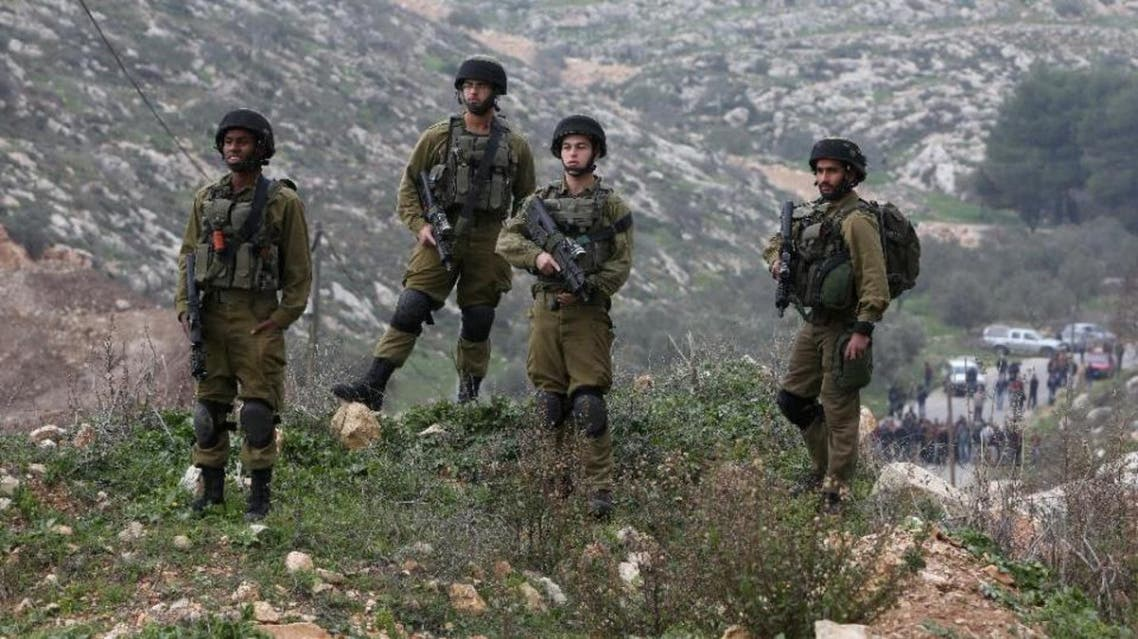 Israeli security forces, pictured on January 14, 2016, are searching for the perpetrator who stabbed a Jewish man from the settlement of Neve Daniel. (AFP)