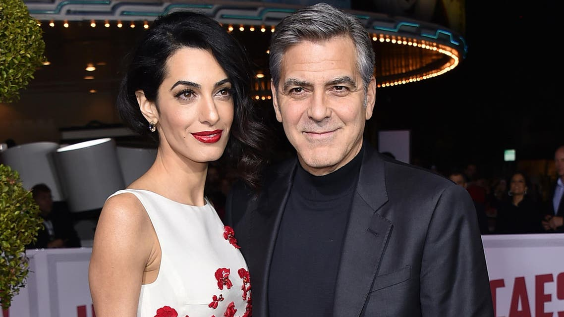 """Amal Clooney, left, and George Clooney arrive at the world premiere of """"Hail, Caesar!"""" at the Regency Village Theatre on Monday, Feb. 1, 2016, in Los Angeles. (AP)"""
