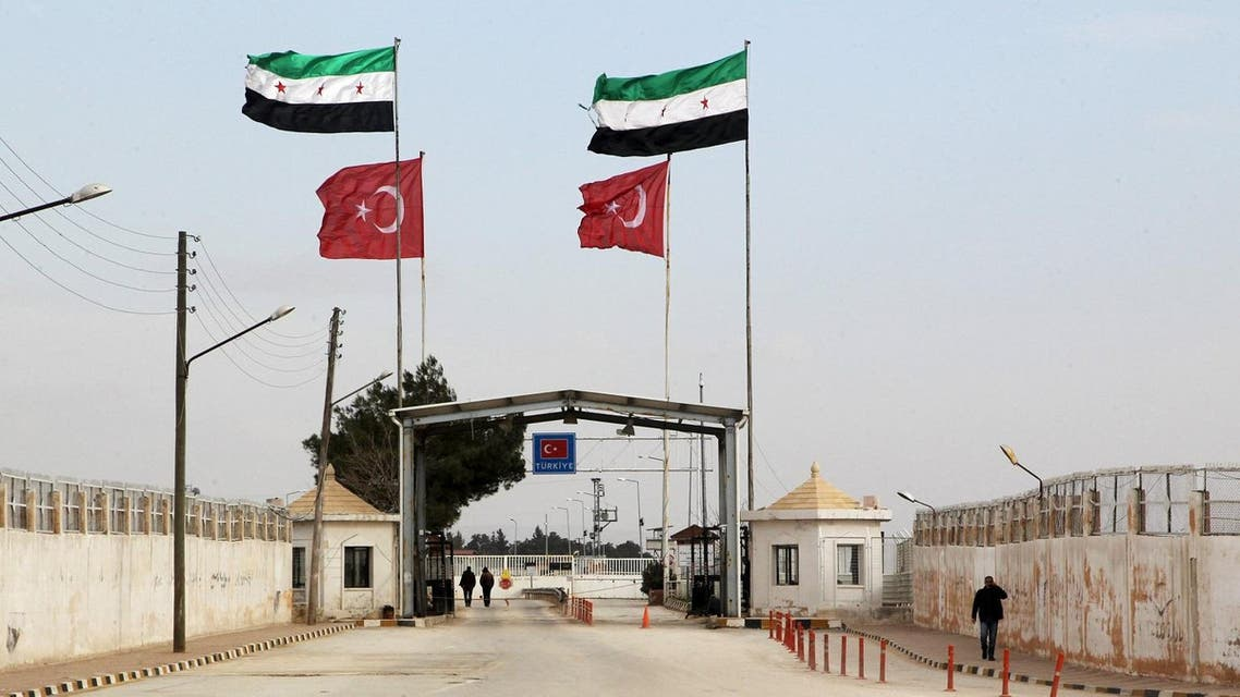 Free Syrian Army and Turkish flags flutter over the Bab Al-Salam border crossing, that is closed from the Turkish side. (Reuters)