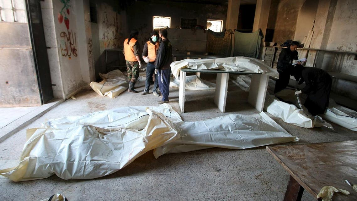 Men attempt to identify bodies after airstrikes by pro-Syrian government forces in the rebel held al-Saleheen neighborhood of Aleppo. (Reuters)