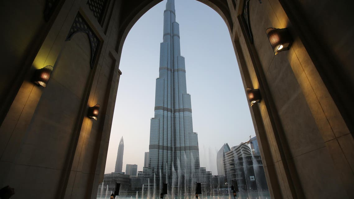 In this Monday, April 13, 2015, with the world tallest tower, Burj Khalifa, in the background, tourists and visitors watch and take photos of the Dubai Fountain in Dubai, United Arab Emirates.  (AP)