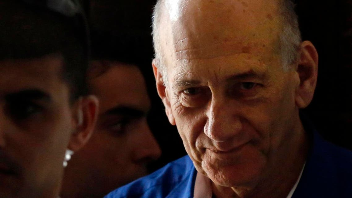 File picture of former Israeli PM Olmert leaving Tel Aviv District Court. (AP)