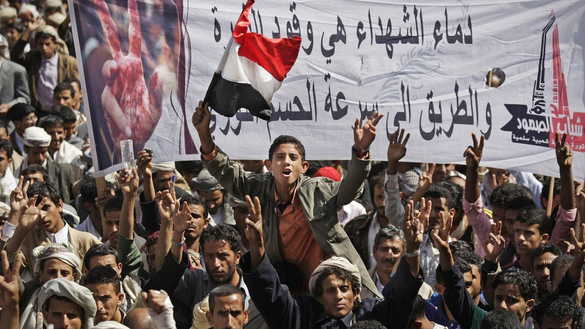 "Yemeni protestors chant slogans while holding up a banner that reads in Arabic, ""blood of the martyrs is the fuel of revolution, it's the way to get victory quickly,"" during a demonstration demanding the resignation of Yemeni President Ali Abdullah Saleh in Sanaa, Yemen, Thursday, Nov. 10, 2011. (AP"