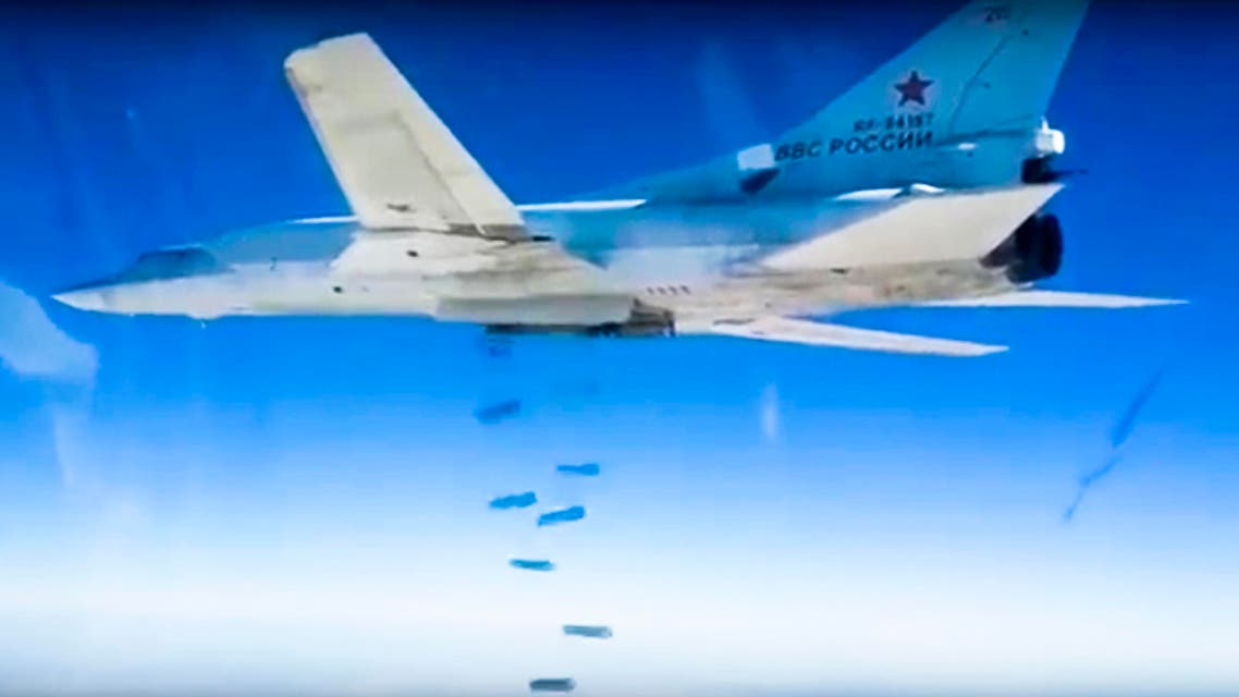 In this photo made from video footage provided by the Russian Defense Ministry on Wednesday, Dec. 9, 2015, a Russian Tu-22M3 bomber drops bombs on a target AP