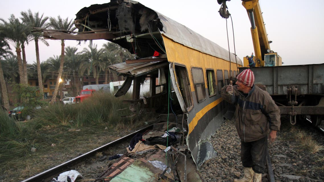 Egyptians railway workers attempt to remove debris from tracks following a train crash in Badrasheen, 40 KM south of Cairo, Egypt, Tuesday, Jan. 15, 2013.