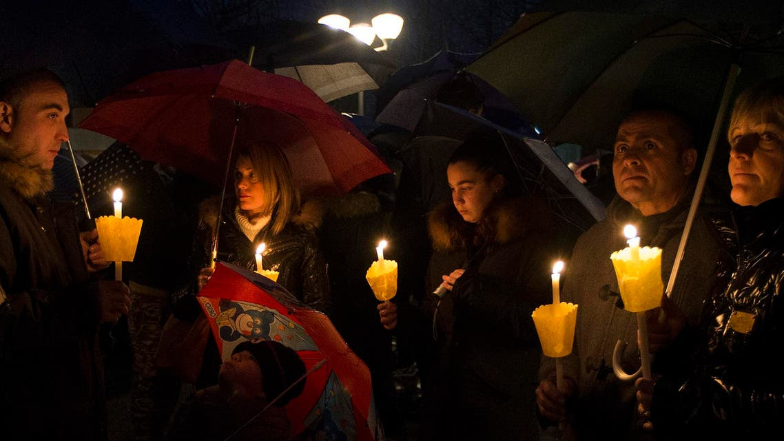 People gather during a candle light procession to honor the memory of Giulio Regeni in Fiumicello, Italy, Sunday, Feb. 7, 2016. (AP)