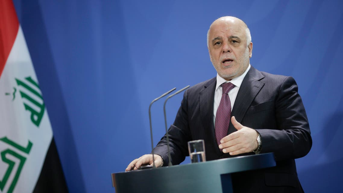Iraqi Prime Minister Haider al-Abadi attends a joint press conference with German Chancellor Angela Merkel at the chancellery in Berlin, Thursday, Feb. 11, 2016. (AP