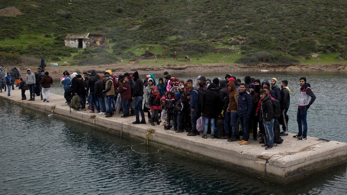 In this Wednesday, Jan. 20, 2016 photo, refugees and migrants who have arrived from Turkey wait for the Greek coast guard. (AP)