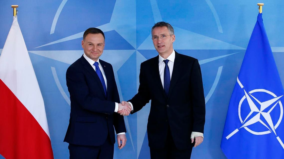 Poland's President Andrzej Duda poses with NATO Secretary-General Jens Stoltenberg (R) at the Alliance headquarters in Brussels, Belgium, January 18, 2016. (Reuters)