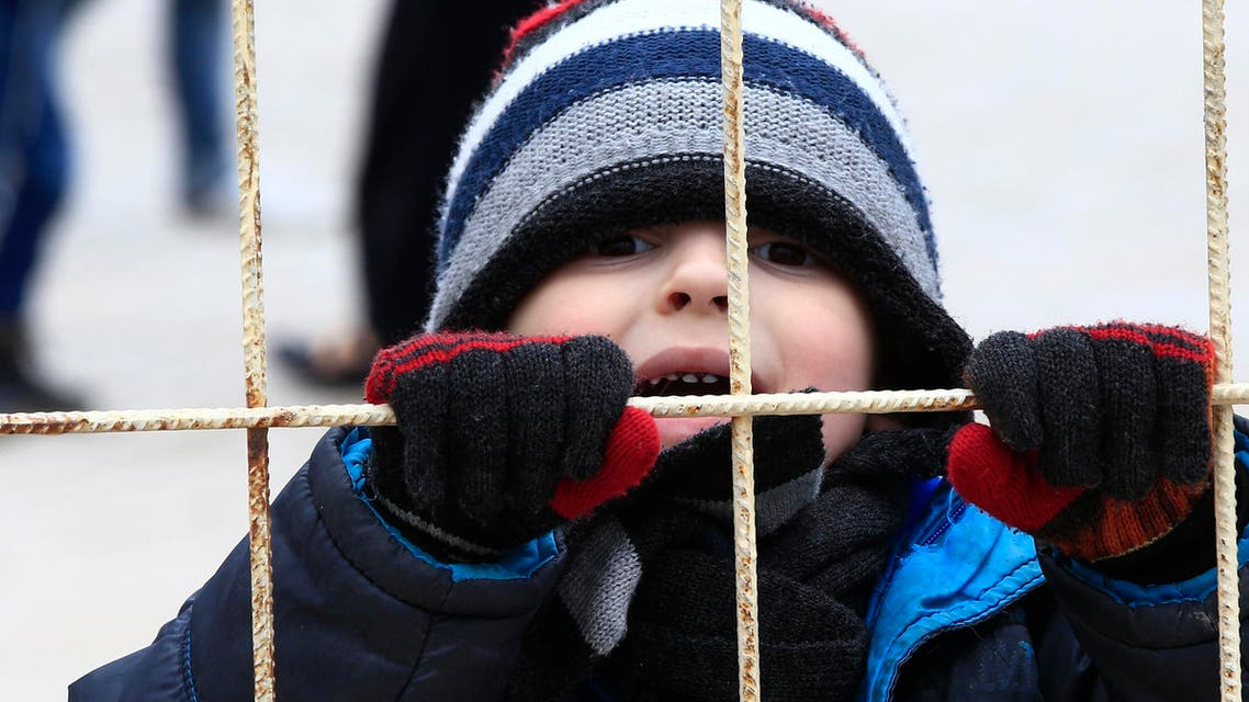 A Syrian child waits to return to his country with members of his family at the Turkish border crossing with Syria in the outskirts of Kilis, southeastern Turkey, Thursday, Feb. 11, 2016. (AP)