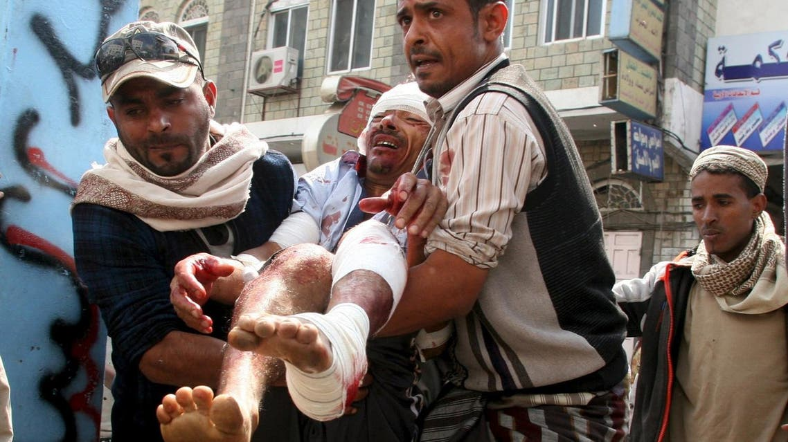 People rush a man to a hospital after he was injured by a Houthi shelling in Yemen's southwestern city of Taez. (Reuters)