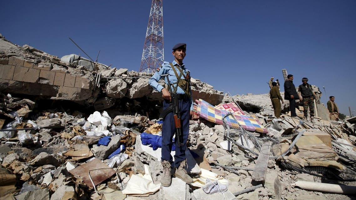 A policeman stands guard on the debris at the site of a Saudi-led air strike on the police headquarters in Yemen's capital Sanaa. (Reuters)