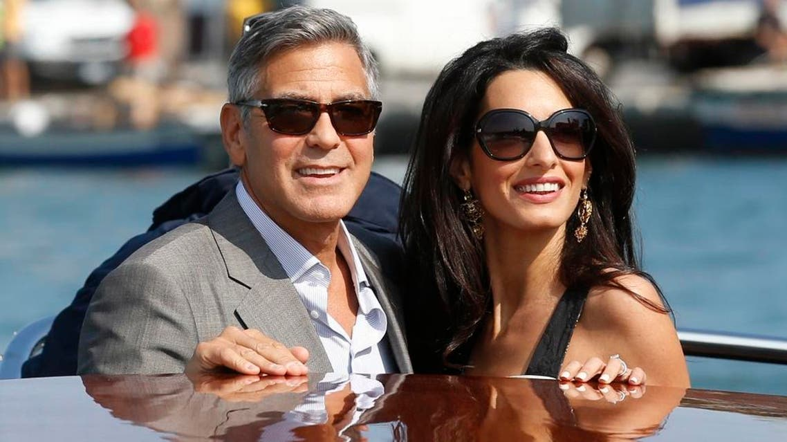 In this Sept. 26, 2014 file photo, George Clooney, left, and Amal Alamuddin arrive in Venice, Italy. Clooney, 53, and Alamuddin, 36, married in Venice, one of the world's most romantic settings. (AP Photo/Luca Bruno, File)