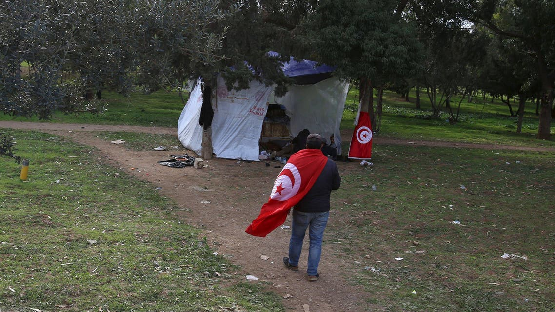 An unemployed Tunisian arriving in the city of Gafsa walks near a tent during a protest at el-Mourouj park to demand the government provide job opportunities, in Tunis, Tunisia, February 11, 2016. (Reuters)