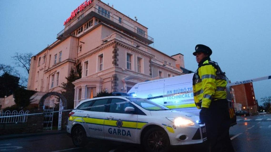 An Irish police officer at the cordon sealing off the Regency Airport Hotel in Dublin on February 5, 2016 following a shooting (AFP)