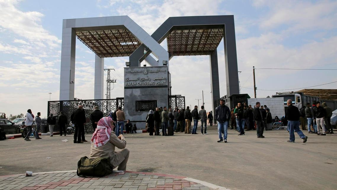 A Palestinian man and others wait outside the gate to cross the border to the Egyptian side at the Rafah crossing, in Rafah City, Gaza Strip, Thursday, Dec. 3, 2015. (AP)