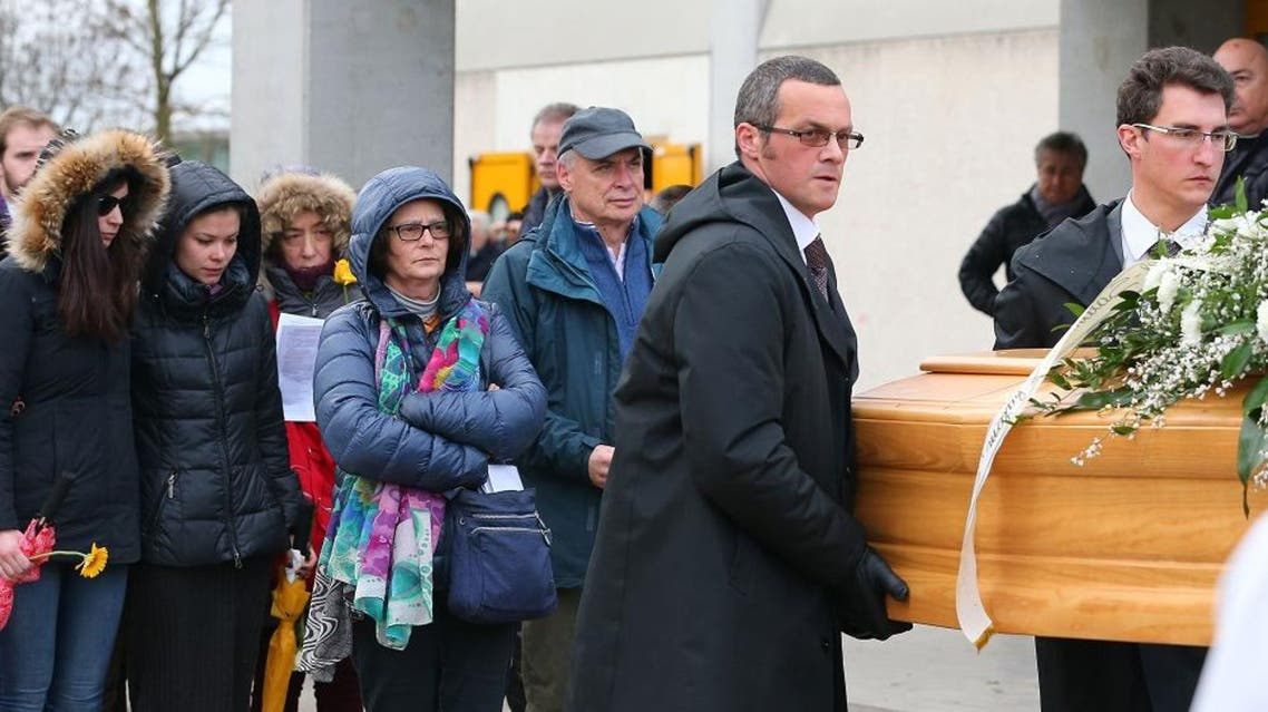 The family of Giulio Regeni - father Claudio, mother Paola and sister Irene - follows the coffin during his funeral service in Fiumicello, Northern Italy, Friday, Feb. 12, 2016. Premier Matteo Renzi, in remarks on Italian state radio, was keeping up the political pressure on the Egyptian government to find and bring to justice whoever tortured and killed Giulio Regeni, who had been living in Cairo for a few months to research Egyptian labor movements for his doctorate from Cambridge University. (AP Photo/Paolo Giovannini)