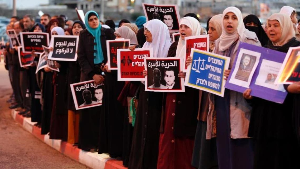 Israeli Arabs take part in a protest calling for the release of Mohammed al-Qiq, a Palestinian prisoner on hunger strike, outside a hospital in the northern Israeli town of Afula on February 9, 2016. (AFP)