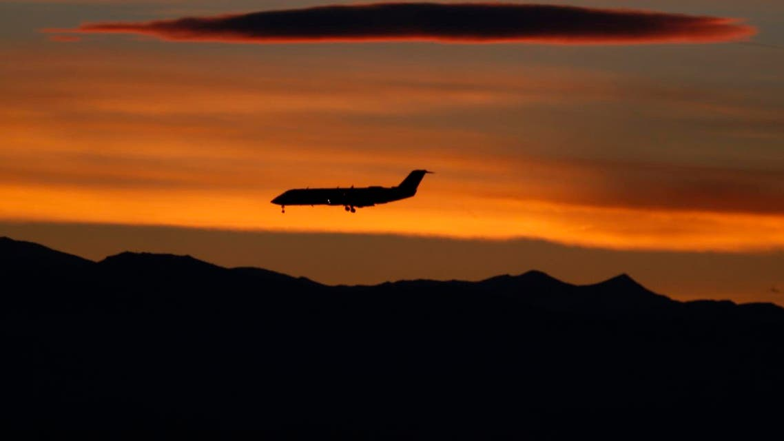 As the suns sets behind the mountains, a passenger plane comes in for a landing at Denver International Airport late Monday, Feb. 8, 2016, in Denver. AP