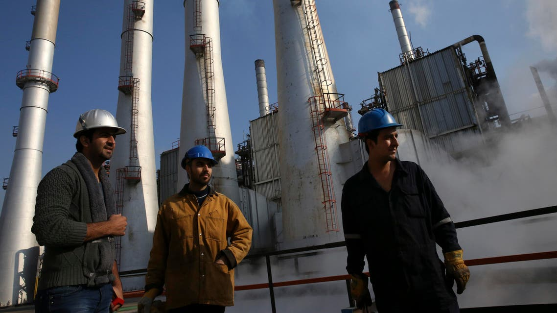 FILE - In this Dec. 22, 2014 file photo, Iranian oil workers gather at the Tehran's oil refinery south of the capital Tehran, Iran. Across a Mideast fueled by oil production, low global prices have some countries running on empty and scrambling to cover shortfalls, even as more regional crude is on tap to enter the market.(AP Photo/Vahid Salemi, File)