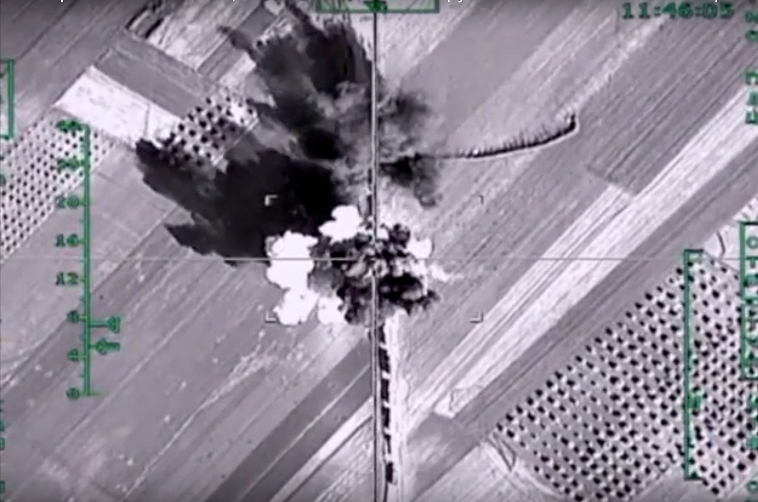In this photo made from the footage taken from Russian Defense Ministry official web site on Monday, Feb. 1, 2016, an aerial image shows what it says is a column of heavy trucks carrying ammunition hit by a Russian air strike near Aleppo, Syria. (AP)