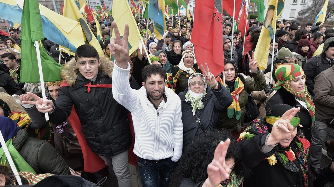 Members of the Kurdish community flash the v for victory sign on February 13, 2016, in Strasbourg, eastern France, during the annual rally of Kurds from all over Europe to denounce the detention of jailed leader of Turkey's Kurd rebels, Abdullah Ocalan. AFP