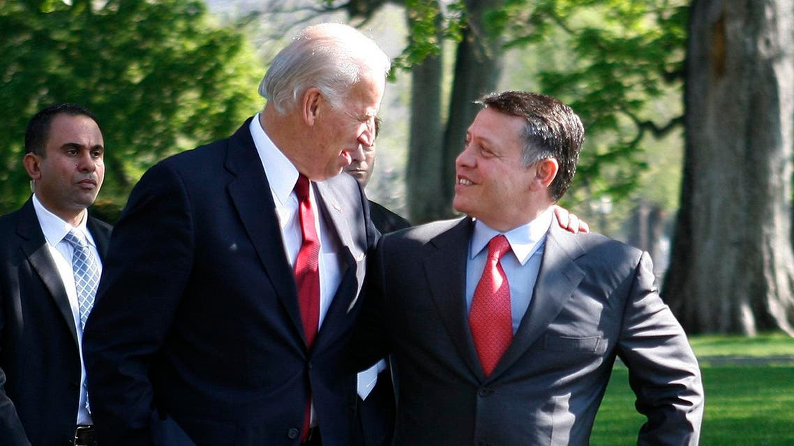 Vice President Joe Biden walks arm and arm with Jordan's King Abdullah II, Tuesday, April 21, 2009, as they arrive at the White House in Washington to meet with President Barack Obama in the Oval Office. (AP)