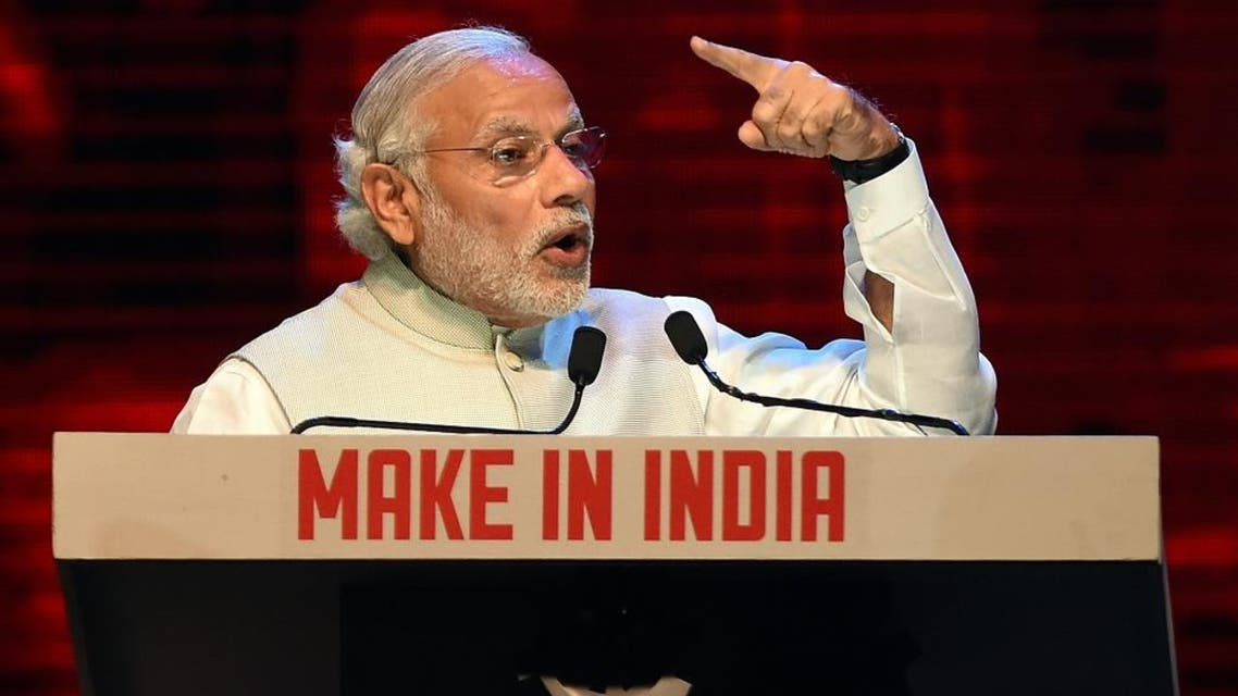Indian Prime Minister Narendra Modi speaks during part of the opening ceremony of 'Make in India Week' in Mumbai on February 13, 2016. Over 190 companies, and 5,000 delegates from 60 countries, are taking part in the first 'Make in India Week' to be held in Mumbai from February 13-18. AFP PHOTO / PUNIT PARANJPE