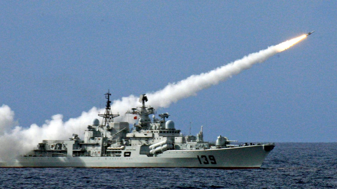 In this July 26, 2010, file photo rleased by China's Xinhua News Agency on July 29, 2010, a warship launches a missile during a live-ammunition military drill held by the South China Sea Fleet of the People's Liberation Army (PLA) Navy in the South China Sea.