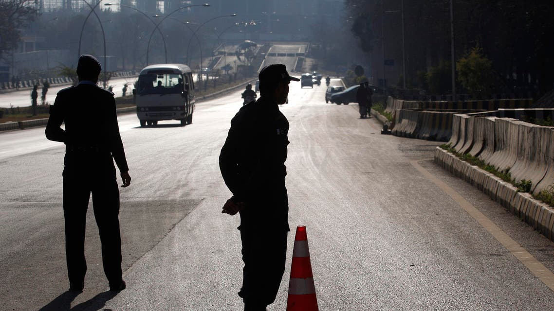 Pakistani police officers stand at a checkpoint outside the Foreign Ministry where a conference for Afghan peace process is going on, Monday, Jan. 11, 2016 in Islamabad, Pakistan.