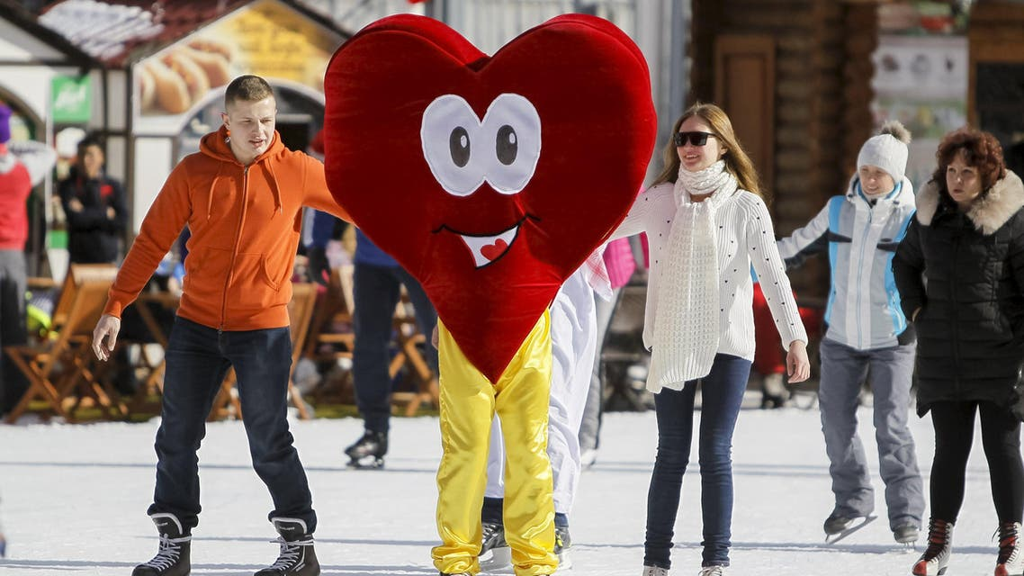 A skater wearing a heart-shaped costume skates during a Valentine's Day celebration at the Medeo skating rink in Almaty, Kazakhstan, February 14, 2016. (Reuters)