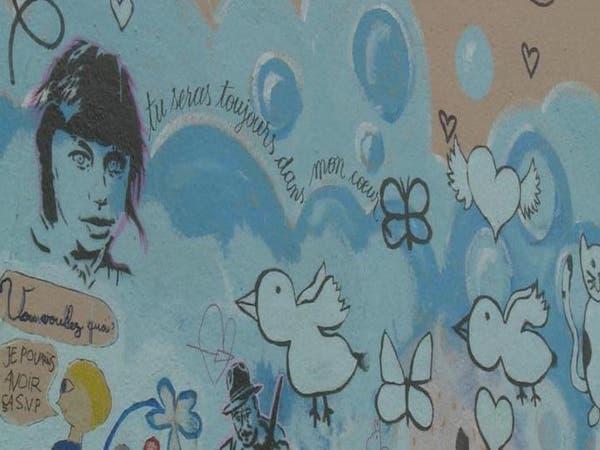 راسمو غرافيتي يحولون جدار في الجتدة العاشرة في باريس للوحة فنية