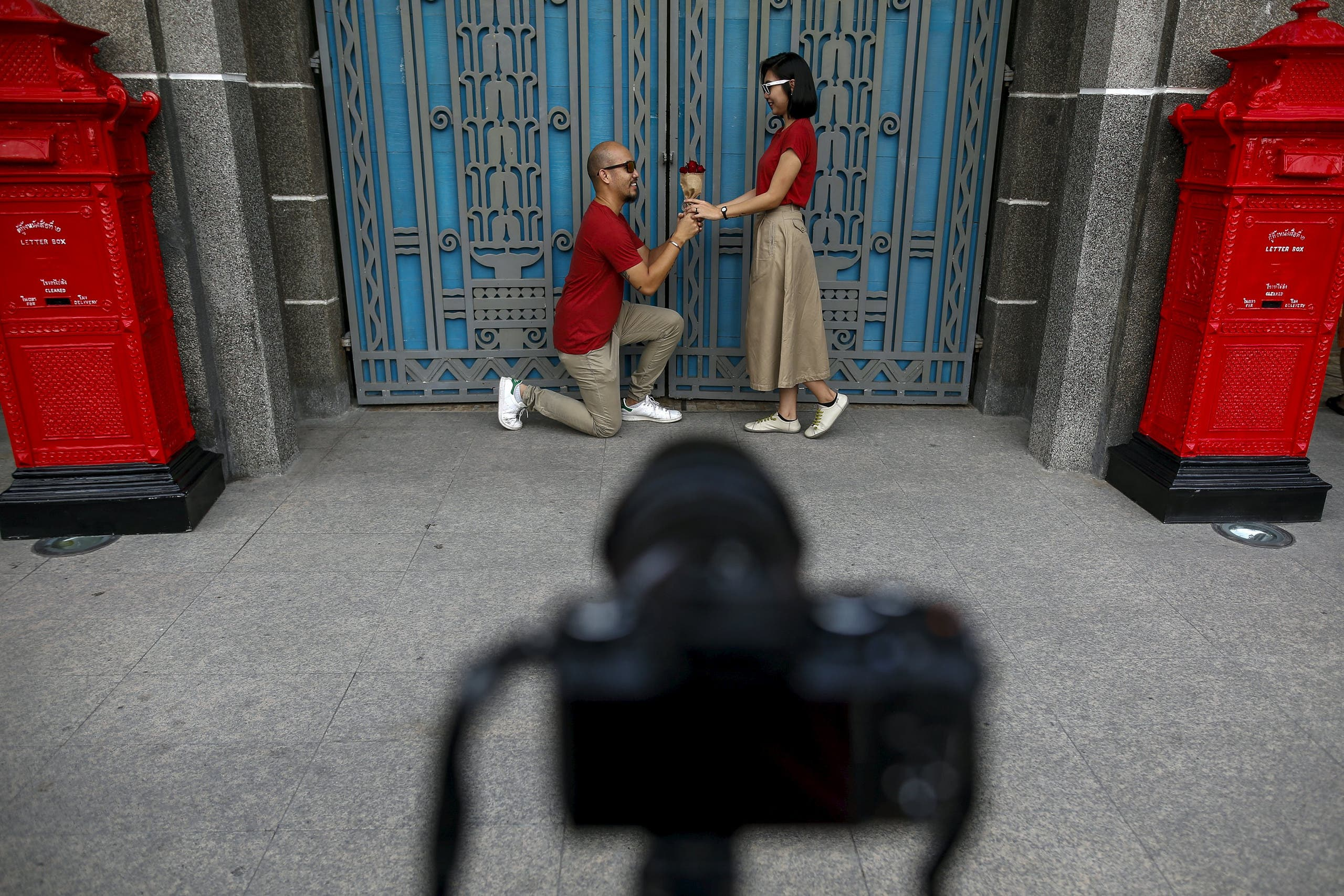 A couple take a selfie during a Valentine's Day celebration at the Bangrak district in Bangkok, Thailand, February 14, 2016. (Reuters)