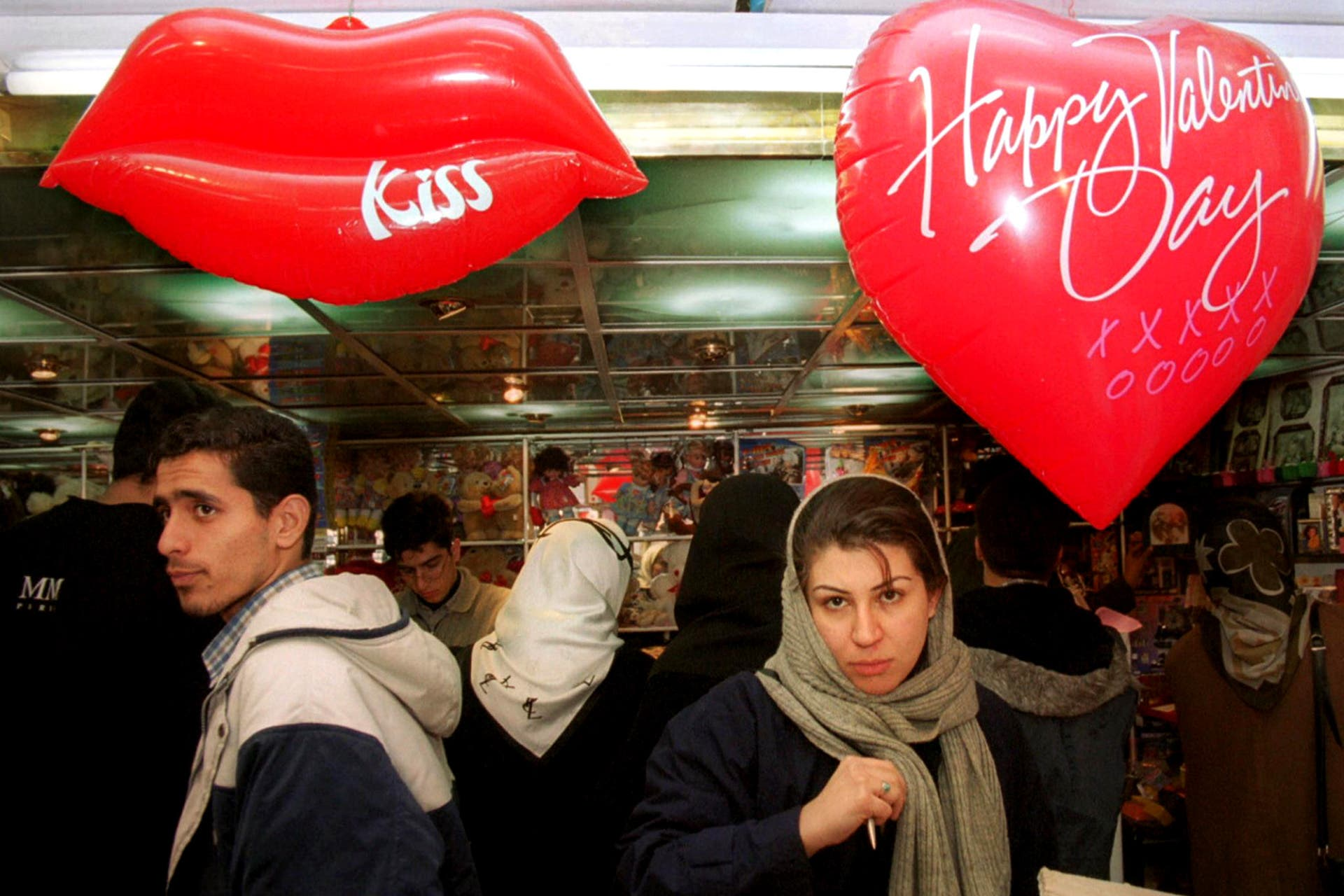 Iranians shop for Valentine's Day gifts at a shop in Tehran in 2001. (AFP)