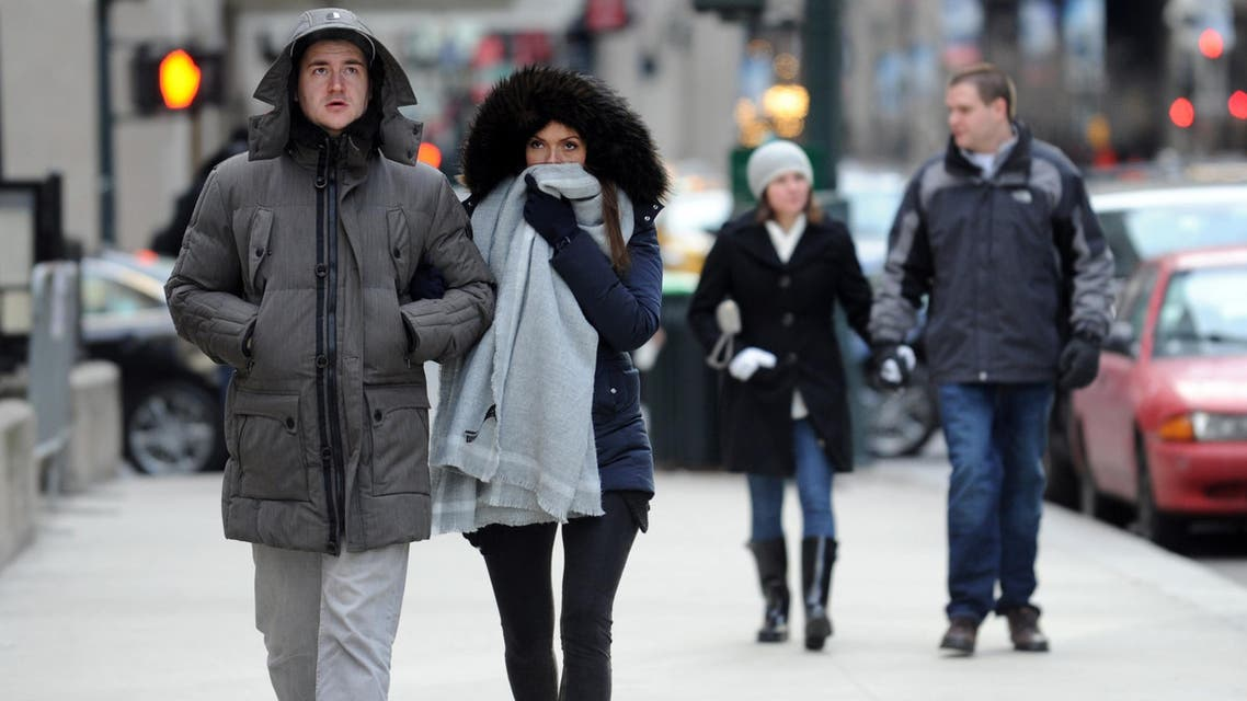 Benedikt Vom Orde and Julia Felte, tourists from Essen, Germany, walk along Park Avenue in New York during a bitter cold spell, Saturday, Feb. 13, 2016. AP