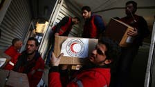 Aid convoy enters rebel-held area near Syrian capital