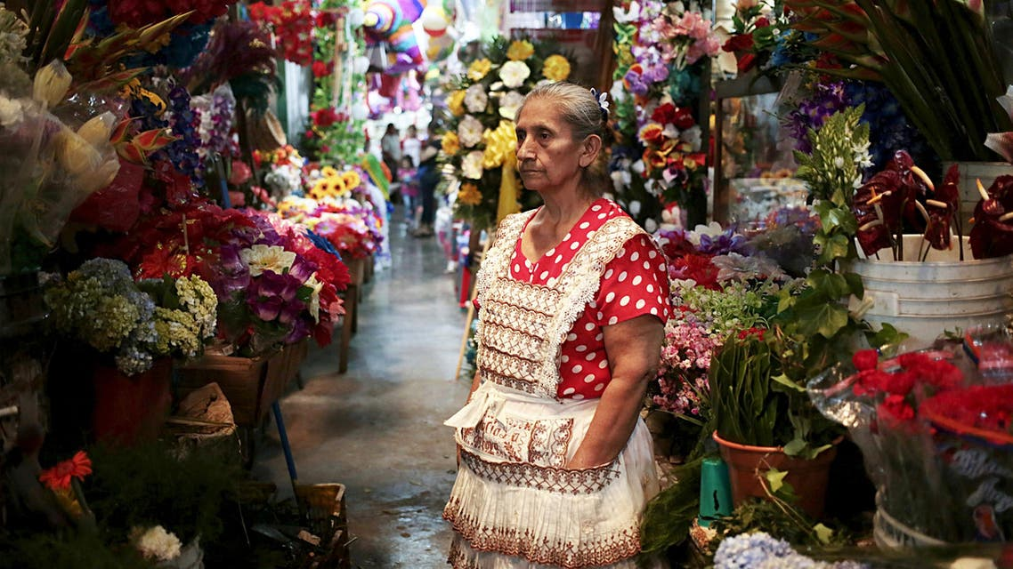 A woman sells flowers at the local market on the eve of Valentine's Day in Managua, Nicaragua February 13, 2016. (Reuters)