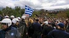 Police fire tear gas at anti-migrant 'hotspot' protest