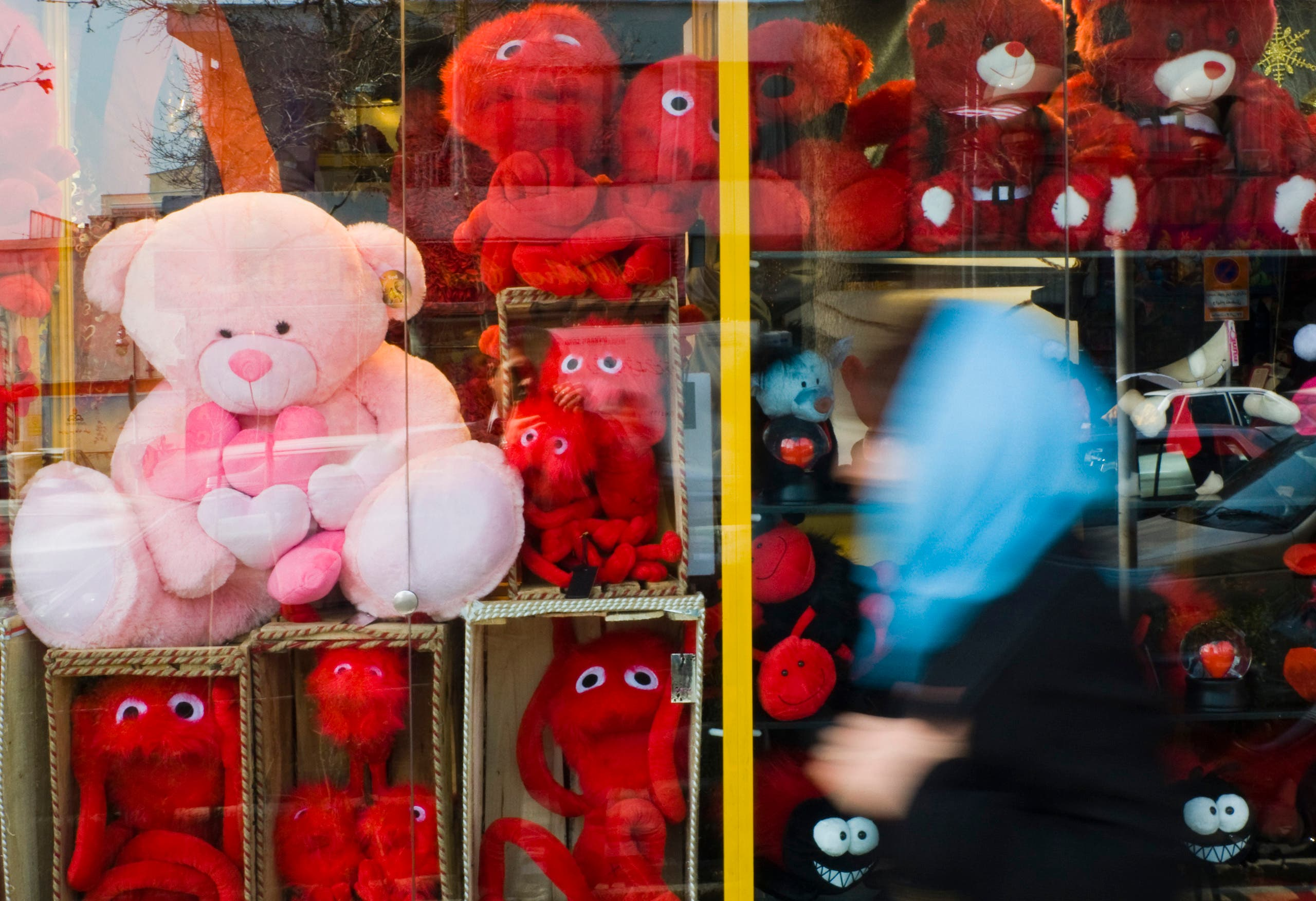 An Iranian woman walks past a shop window while Valentine's Day shopping in Tehran - February 14, 2010. (Reuters)