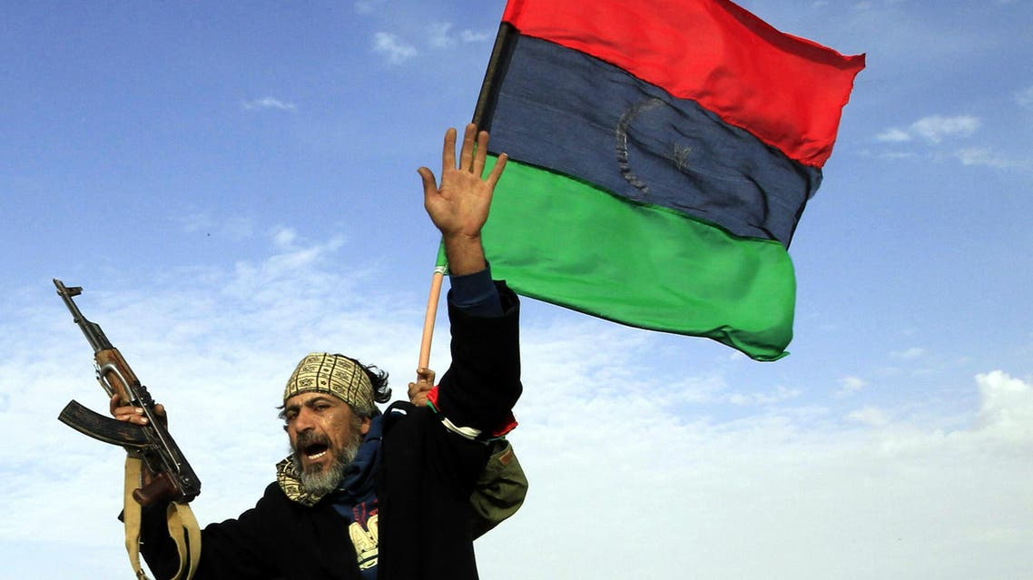 A rebel soldier gestures atop a car as he heads to Brega, in Ajdabiya March 2, 2011. REUTERS/Goran Tomasevic