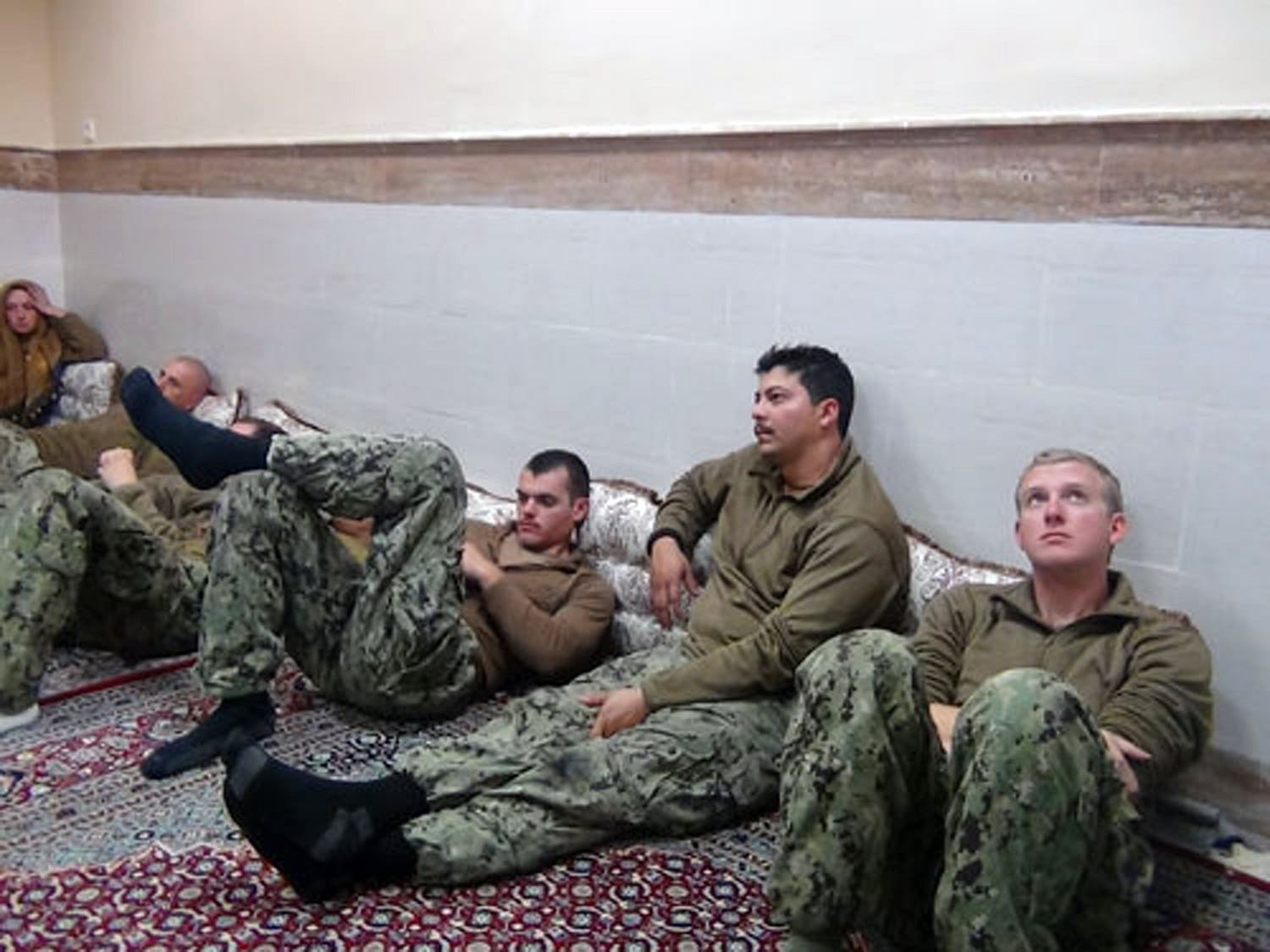 This picture released by the Iranian Revolutionary Guards on Wednesday, Jan. 13, 2016, shows detained American Navy sailors in an undisclosed location in Iran. (AP)
