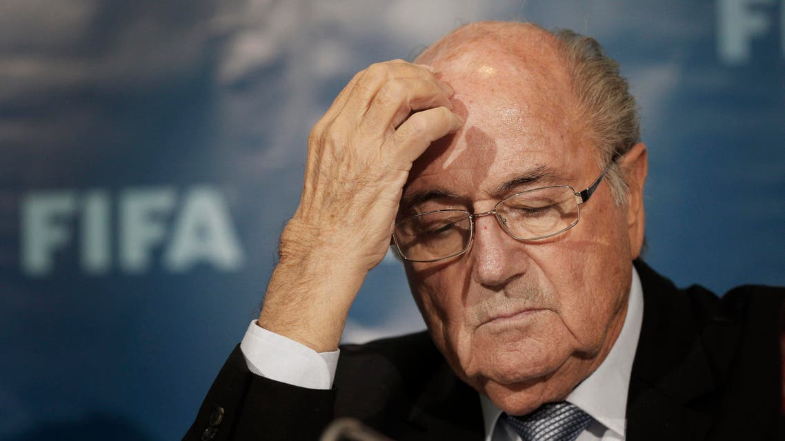 FILE - In this Dec. 19, 2014 file photo FIFA President Sepp Blatter gestures as he attends a news conference in Marrakech, Morocco. The FBI is investigating Blatter's role in a kickbacks scandal that involved his predecessor as FIFA president, Joao Havelange, the BBC reported Sunday, Dec. 6, 2015. (AP Photo/Christophe Ena, File)