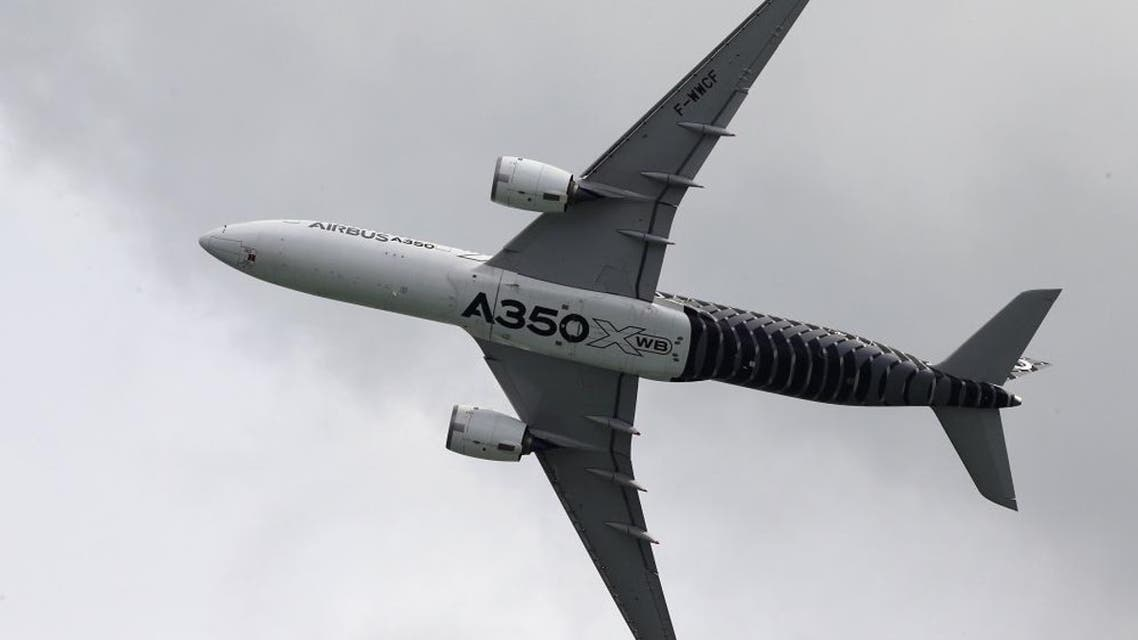 An Airbus A350 flies past during a preview aerial display of the Singapore Airshow at Changi exhibition center in Singapore February 14, 2016. The airshow will take place from February 16-21. REUTERS/Edgar Su