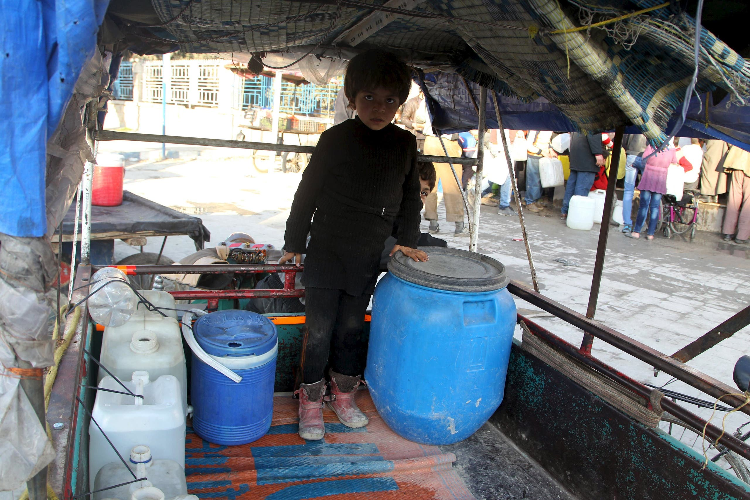 A smile is rare for children of war-torn Syria