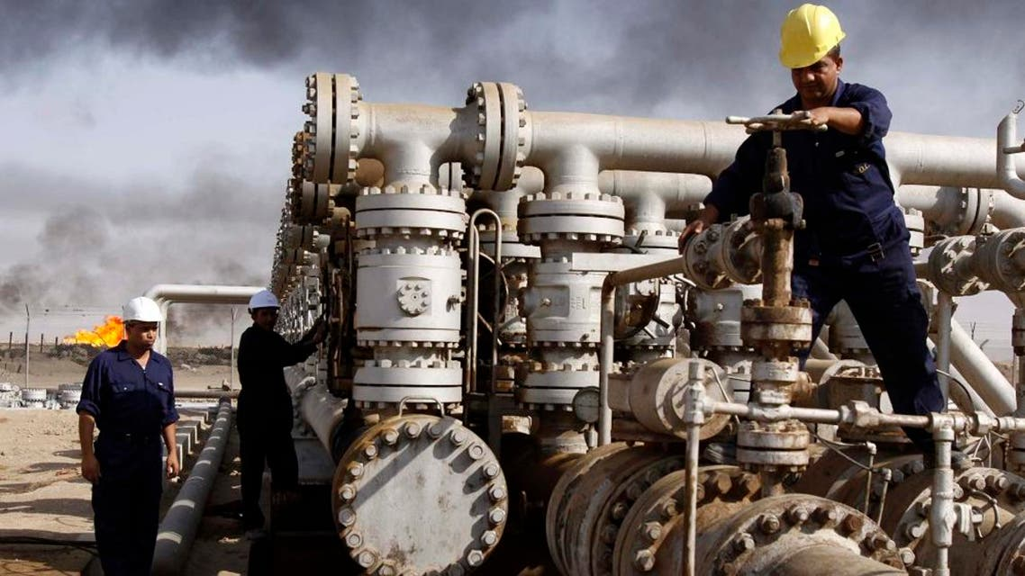 In this Dec. 13, 2009 file photo, Iraqi workers are seen at the Rumaila oil refinery, near the city of Basra, 340 miles (550 kilometers) southeast of Baghdad, Iraq. Plunging oil prices have pitched Iraq into a severe financial crisis as it struggles to combat the Islamic State group, play host to millions of refugees and rebuild cities and towns ravaged by war. With global prices hovering around $30 a barrel, Iraq has had to draw on foreign exchange reserves to fill a shortfall in the 2016 budget, which anticipated $45 per barrel. (AP Photo/Nabil al-Jurani, File)