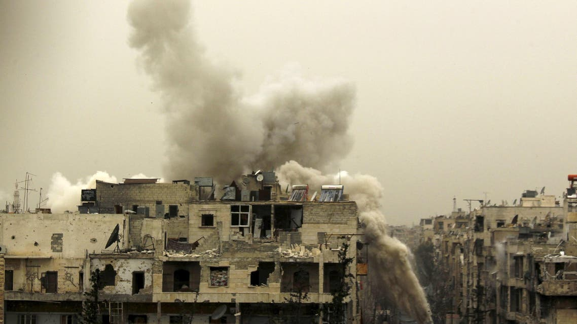 Smoke rises after a shell fell on a building that forces loyal to Syria's president Bashar Al-Assad are located in, after being fired from rebel fighters in the Seif El Dawla neighbourhood in Aleppo March 28, 2015. (Reuters)