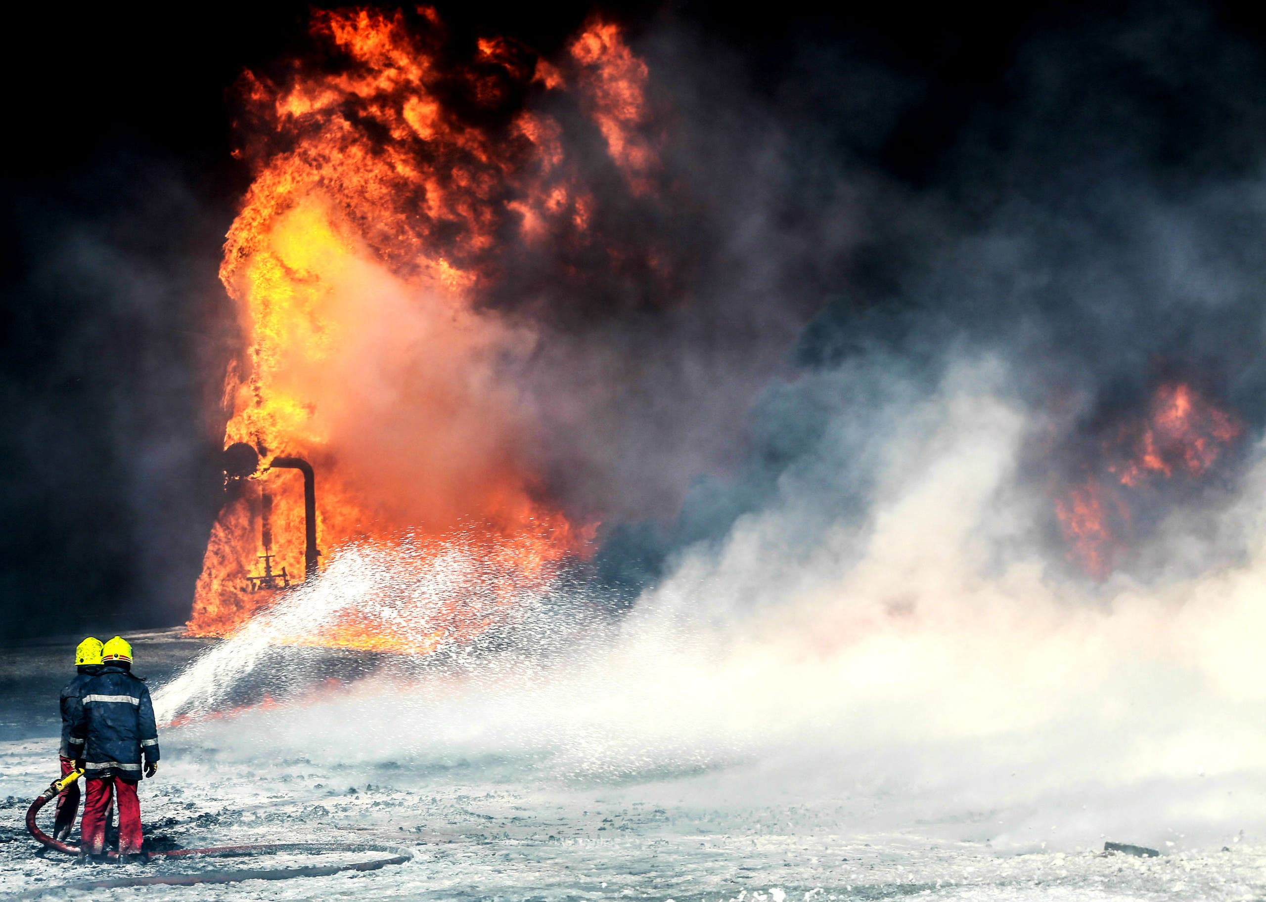 Firefighters try to put out the fire in an oil tank in the port of Es Sider, in Ras Lanuf, Libya, believed to be caused by ISIS -  January 6, 2016. (Reuters)